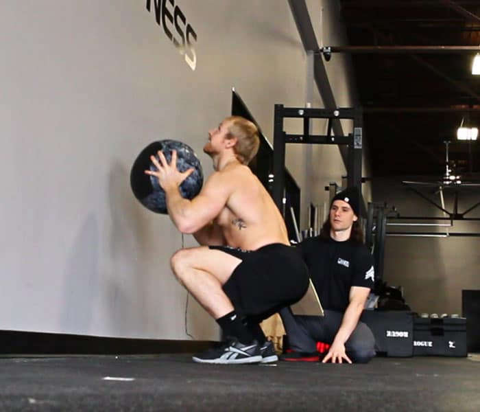 guy doing ball squats