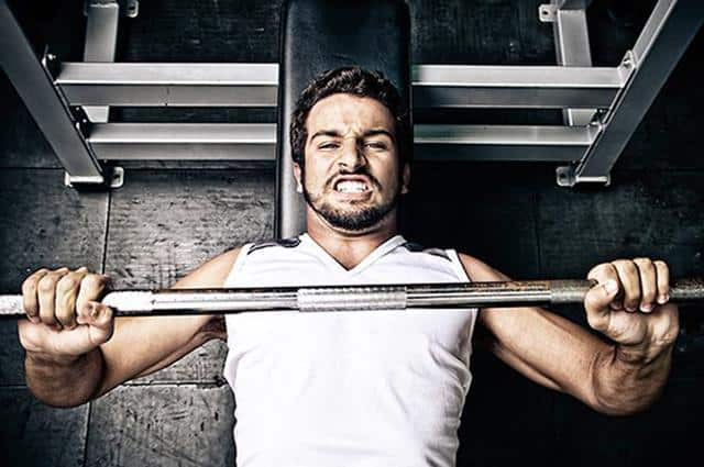 Too much, too soon - Man lifting heavy weights