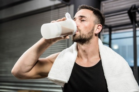 image of athlete drinking pre workout drink