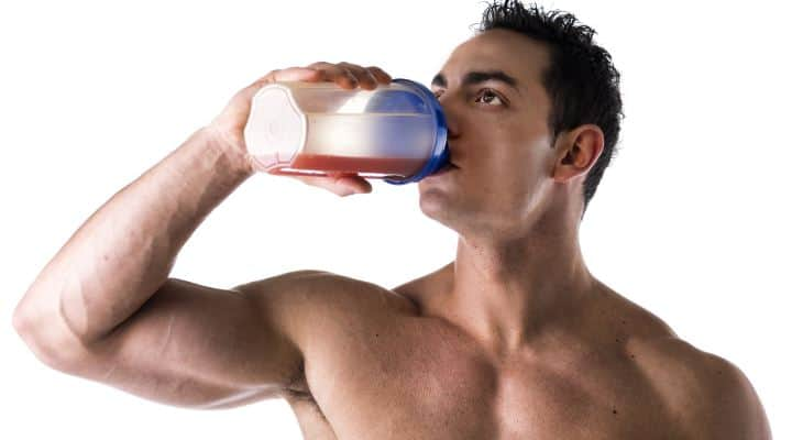 man drinking pre workout drink