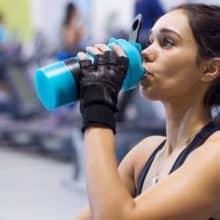 girl at gym drinking shake