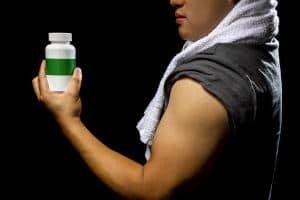 gym rat holding a supplement bottle
