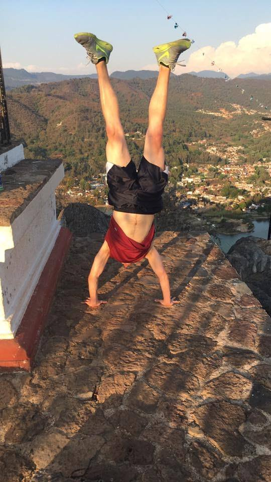 Jake on handstands near a steep drop-off