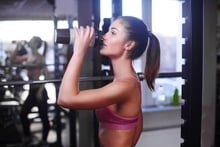 Young athletic woman drinking sports nutrition shake