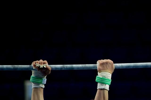 hands gripping bar