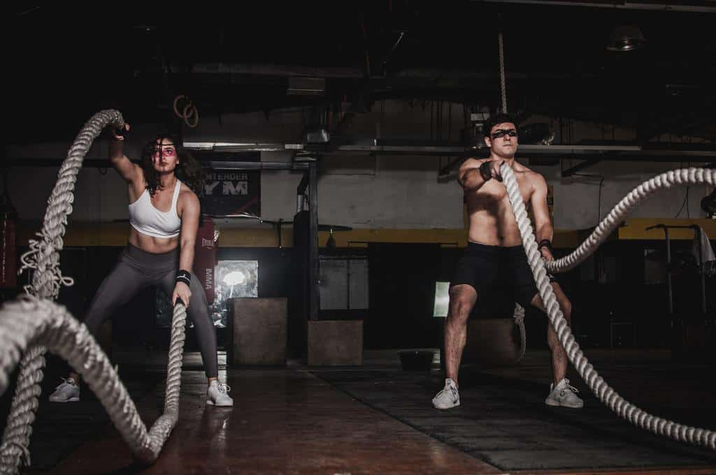 couple holding battle ropes