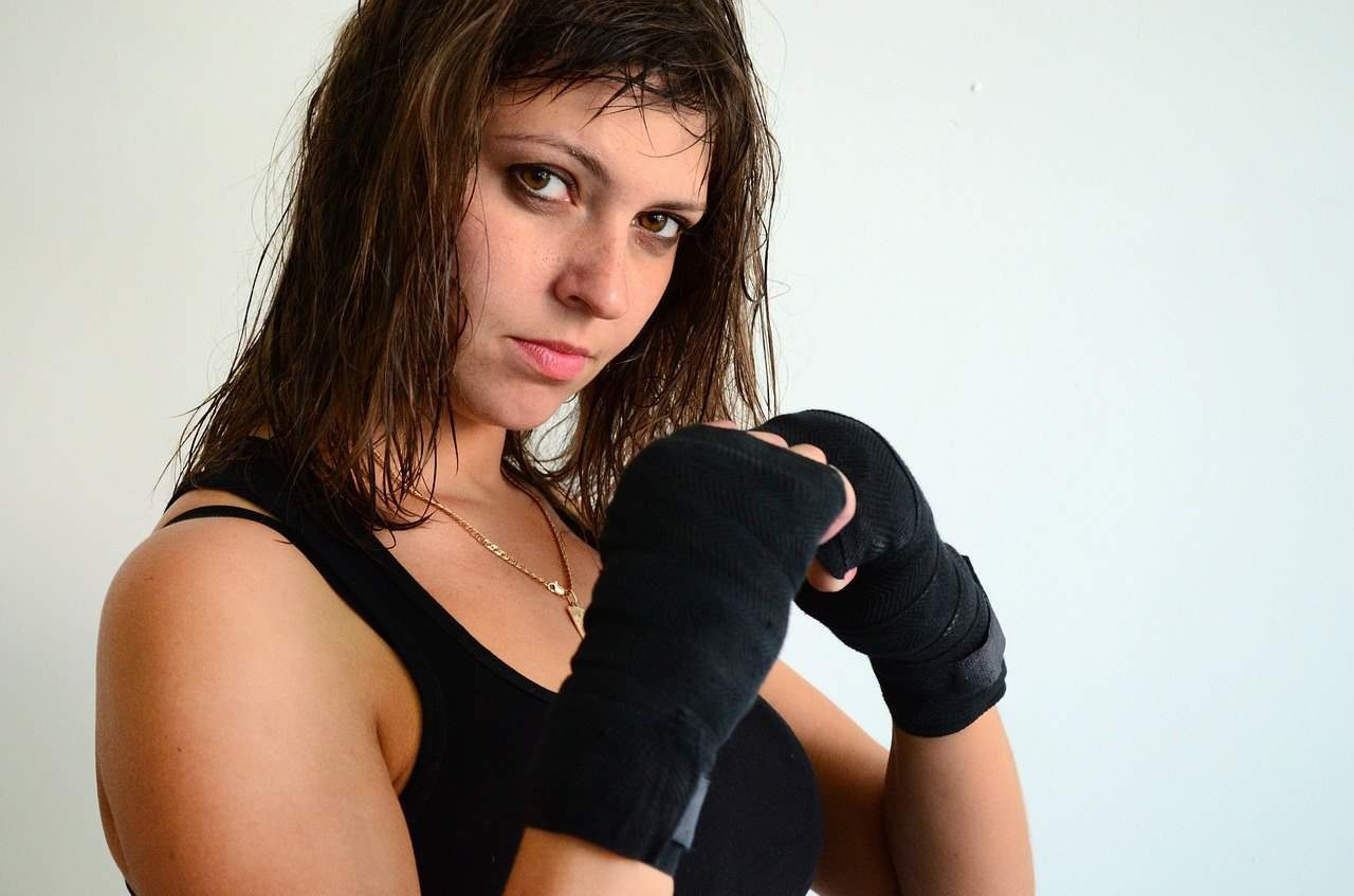 young girl all prepped up for a workout wearing hand wraps