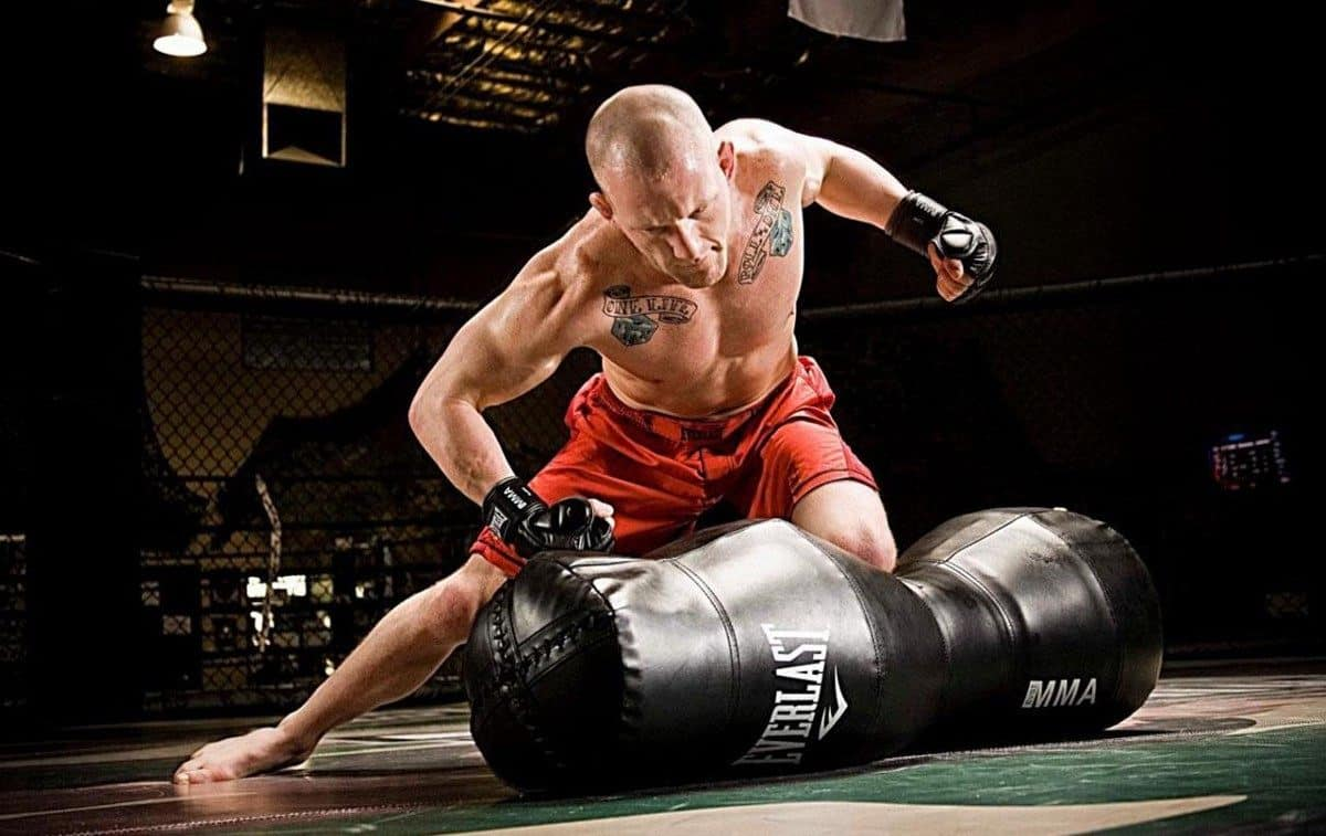 MMA athlete training with a free standing punching bag