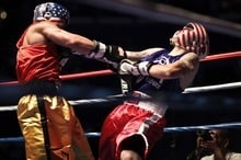 boxers wearing head gears on a fight