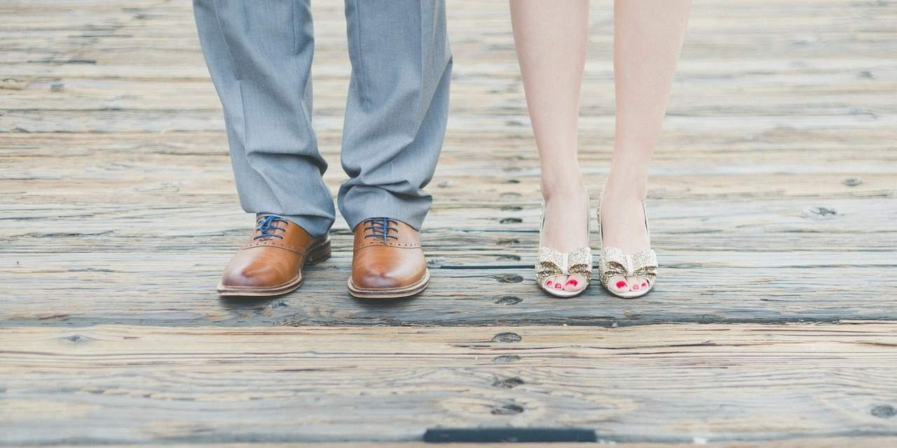 couple wearing pairs of  shoes