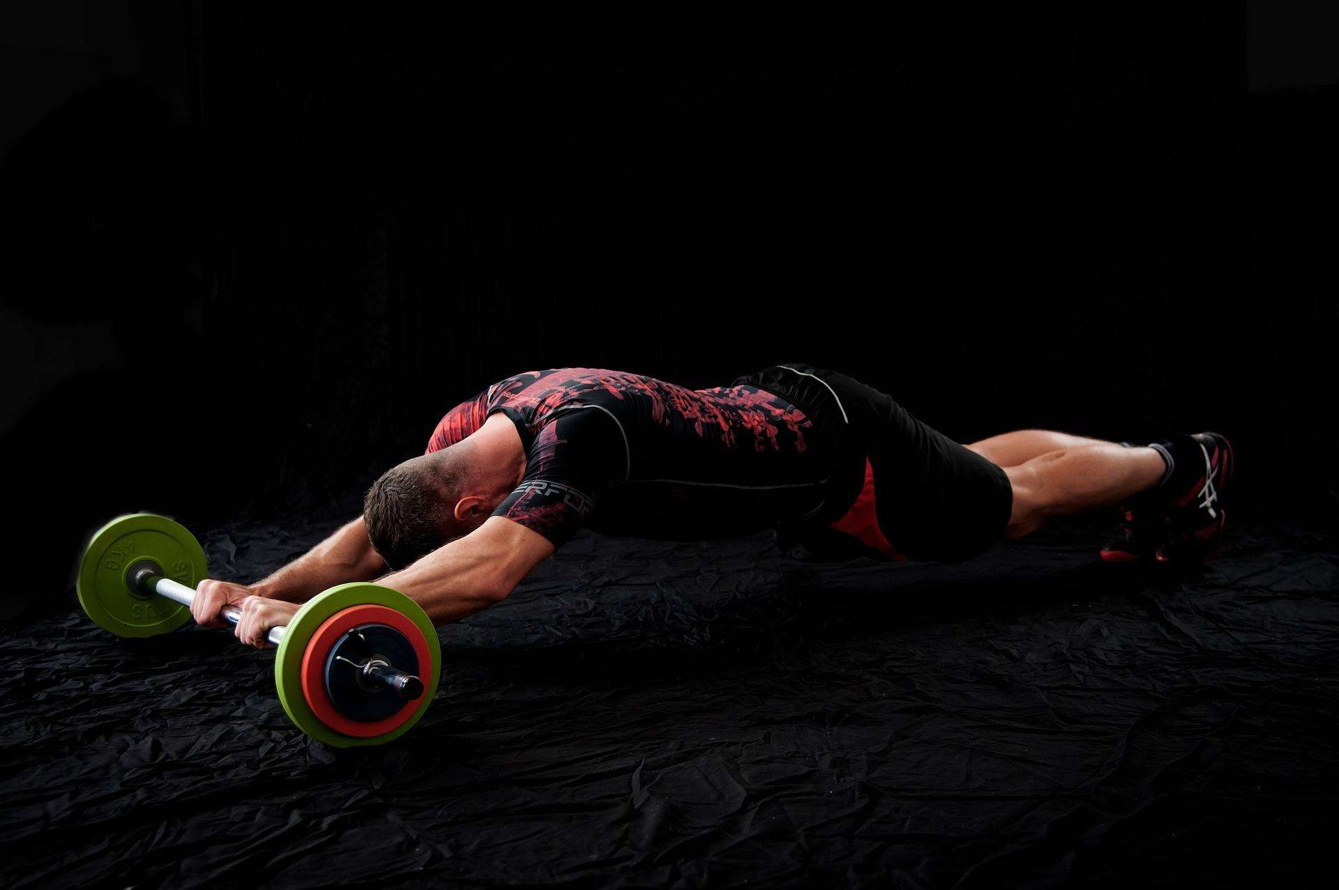 a guy training with crossfit barbell