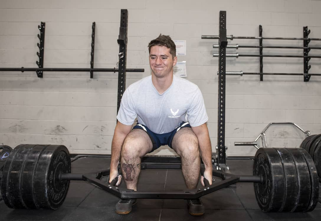a military guy about to lift with a hex bar
