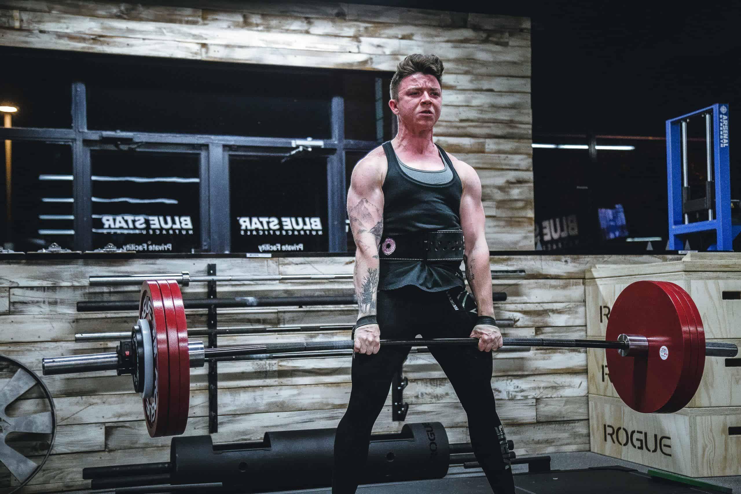 inked guy lifting